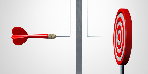 Around a barrier business concept as a red dart solving an obstacle problem by averting a wall and hitting the target as a success metaphor for agility and dexterity in achieving your goal.